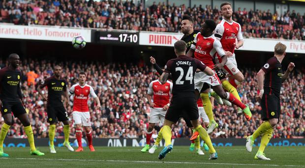 Shkodran Mustafi, right, earned a share of the points for Arsenal