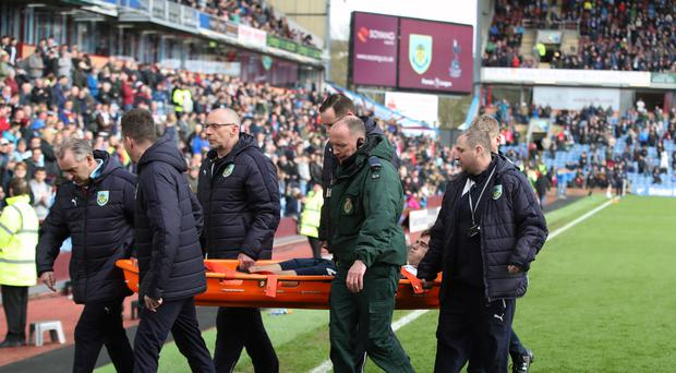 Harry Winks had to be stretchered off with an ankle injury against Burnley on Saturday