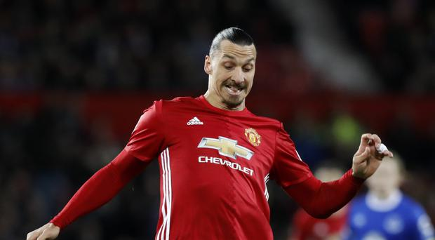 Manchester United's Zlatan Ibrahimovic earned his team a point with a stoppage time penalty against Everton.