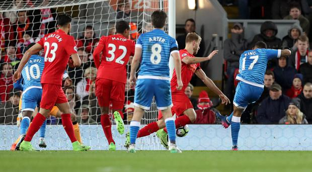 Joshua King, right, fires in a Bournemouth leveller late on