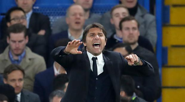 Chelsea head coach Antonio Conte insists he is happy at Stamford Bridge