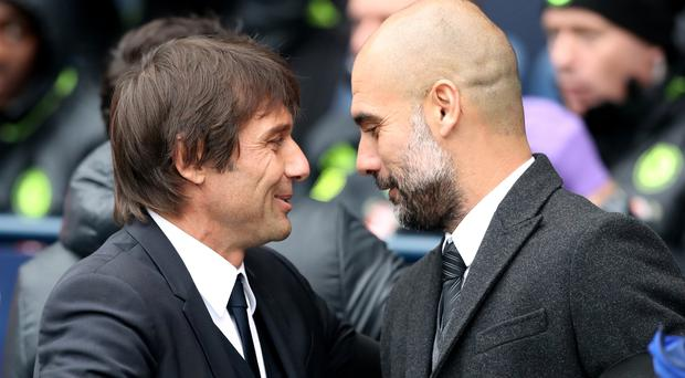 Antonio Conte, left, and Pep Guardiola, right, both played down reports of a tunnel bust-up