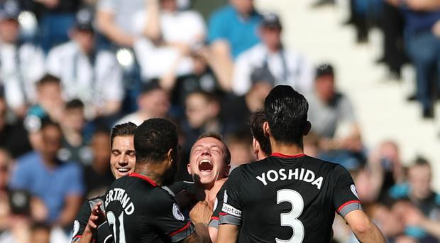 Southampton's Jordy Clasie is mobbed by his team-mates after scoring the winner in their 1-0 victory at West Brom