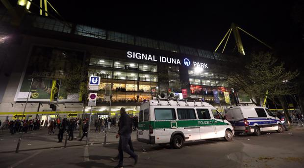 Police gather outside Borussia Dortmund's ground after Tuesday's game with Monaco was postponed following an attack on the team coach