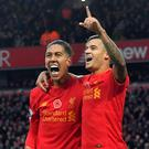 Roberto Firmino, pictured left, and Philippe Coutinho, right, cannot carry Liverpool's Champions League hopes on their own