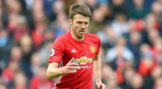 Michael Carrick is still hoping for a top-four finish with Manchester United this season