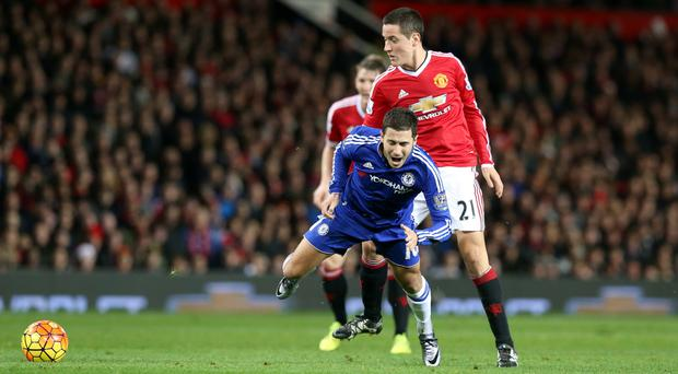 Ander Herrera, right, was sent off for fouling Eden Hazard when the clubs met last month