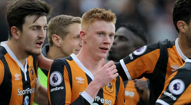 Sam Clucas, centre, takes the plaudits after scoring Hull's second goal