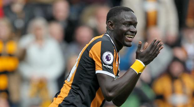 Oumar Niasse reacts with disbelief to his red card