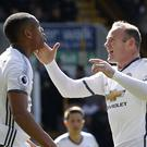 Anthony Martial, left, and Wayne Rooney were both on target at Turf Moor