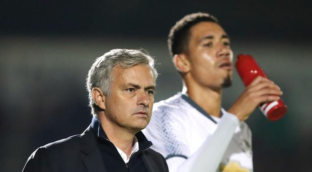Jose Mourinho, left, wants Chris Smalling and Phil Jones to bolster his defensive options