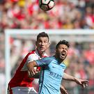 Laurent Koscielny, left, and Sergio Aguero battled for the ball at Wembley