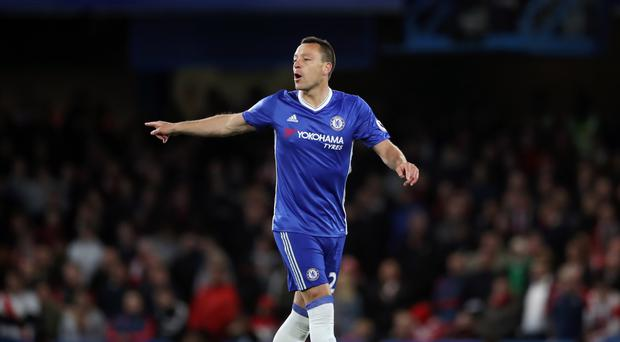 John Terry, pictured, could move to China, says Shanghai Shenhua boss Gus Poyet
