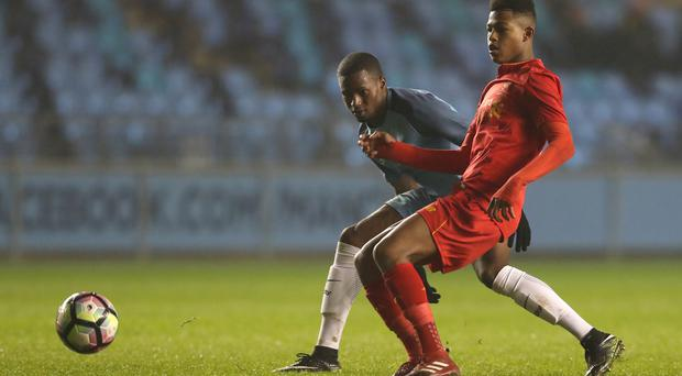Liverpool academy striker Rhian Brewster, right, has impressed with how he has handled his rapid rise