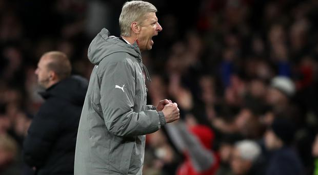 Arsene Wenger celebrates Arsenal's narrow win over Leicester