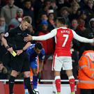 Alexis Sanchez was booked following a late incident in Arsenal's win over Leicester