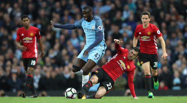 Yaya Toure, centre, says the balance of power in Manchester has shifted to the blue side of the city