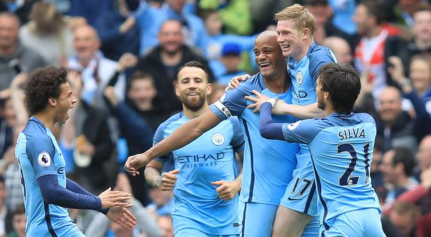 Vincent Kompany, centre, celebrates his goal with fellow scorers, from right, David Silva, Kevin De Bruyne and Nicolas Otamendi