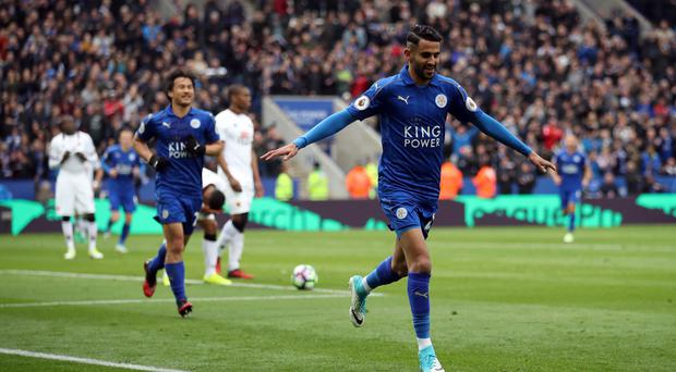 Leicester's Riyad Mahrez celebrates his goal in their 3-0 win over Watford on Saturday.