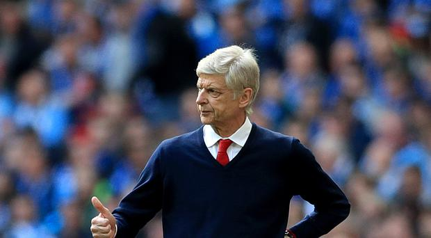 Arsenal manager Arsene Wenger says he would always try to avoid criticising his players in public