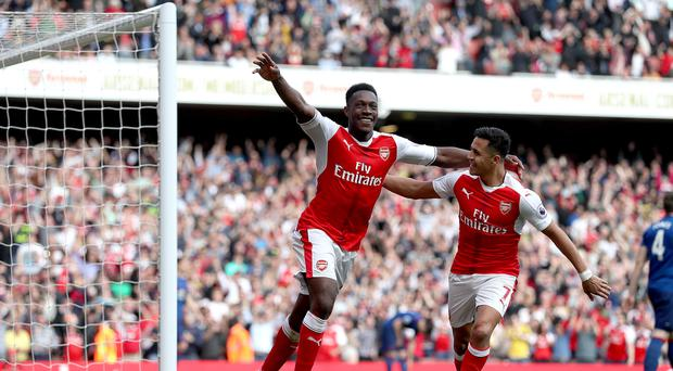 Arsenal's Danny Welbeck, left, celebrates scoring his side's second goal against Manchester United