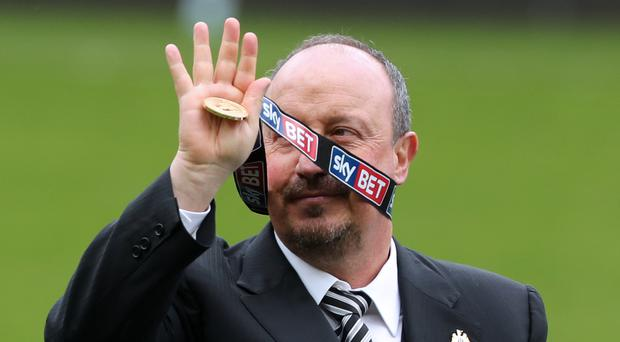 Newcastle manager Rafael Benitez shows off his Sky Bet Championship winner's medal