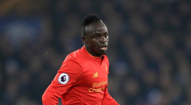 Liverpool's Sadio Mane won the two main prizes at the club's Player of the Season awards.