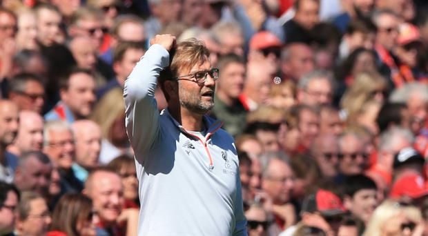Liverpool manager Jurgen Klopp does not believe they are that far behind champions-elect Chelsea
