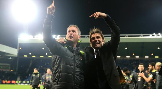 Antonio Conte, right, celebrates after the final whistle with assistant coach Steve Holland
