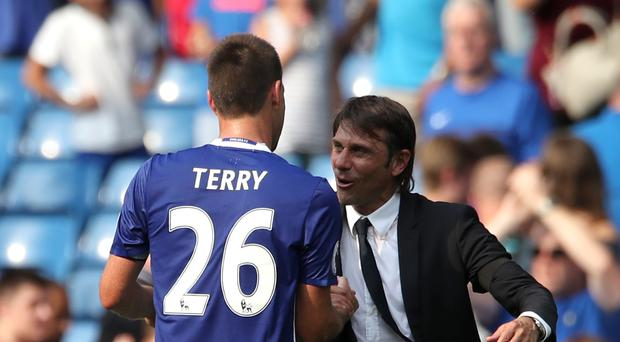 Chelsea head coach Antonio Conte, right, may show sentiment in the final two home games of the Blues career of John Terry, left