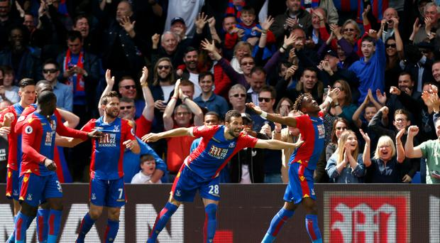 Wilfried Zaha scored the opening goal as Crystal Palace relegated Hull after a 4-0 home victory