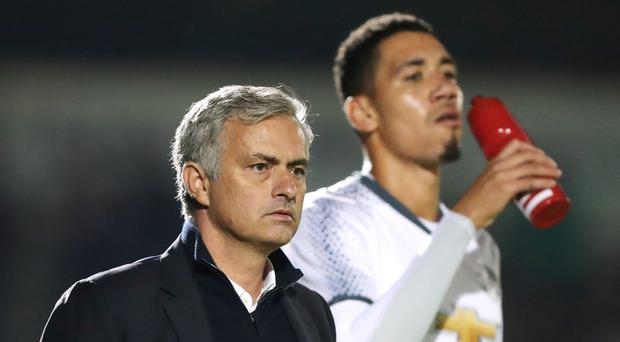 Chris Smalling, right, insists he has a good relationship with Jose Mourinho