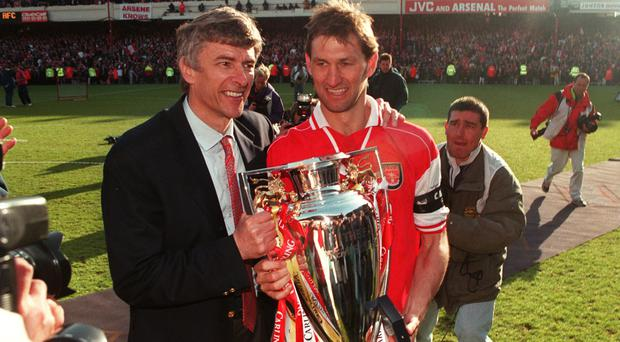Arsenal won the league with Arsene Wenger as boss and Tony Adams as captain in 1997-98.