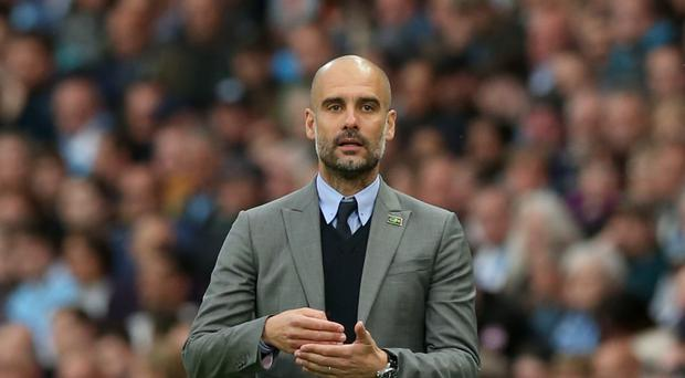 Pep Guardiola, pictured, has until 2020 to buy Eres Unal back from Villarreal
