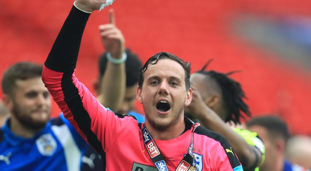 Liverpool goalkeeper Danny Ward would like to extend his loan stay at Huddersfield after helping the Terriers in to the Premier League.