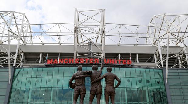 A statue of Manchester United's 'Holy Trinity' of Sir Bobby Charlton, George Best and Denis Law outside the stadium before the game