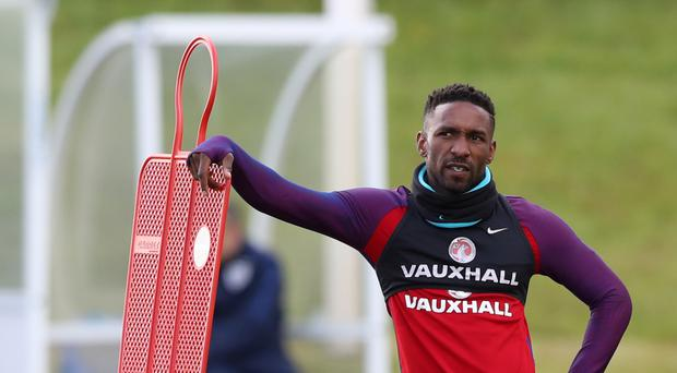 England striker Jermain Defoe has joined Bournemouth on a three-year contract
