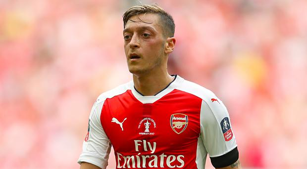 Arsenal almost tripled their transfer record when signing Germany's Mesut Ozil in 2013