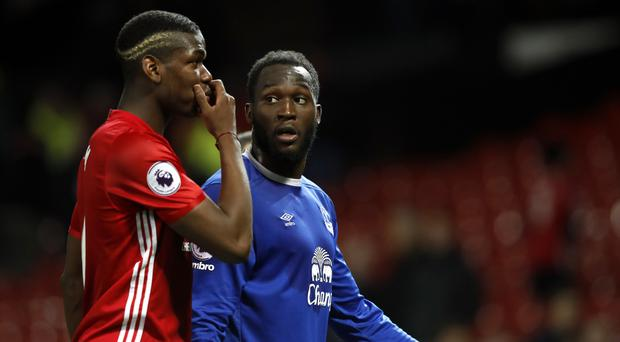 Everton striker Romelu Lukaku, right, is training in Los Angeles with close friend Paul Pogba, left, while a deal is thrashed out for his transfer to Old Trafford