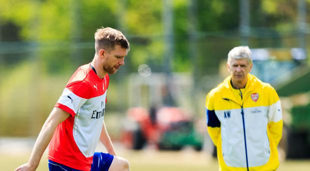 Arsenal club captain Per Mertesacker, left, is set to take on a role in charge of the Academy from 2018