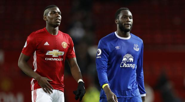 Manchester United could break the record fee they spent on Paul Pogba, left, to bring Romelu Lukaku to Old Trafford
