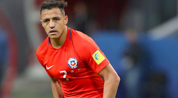 Still a Gunner: Alexis Sanchez may be staying with Arsenal