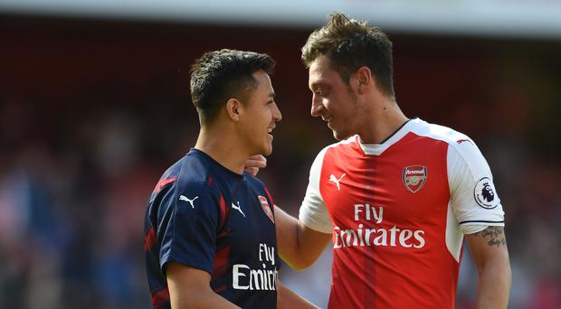 Mesut Ozil, right, hopes Alexis Sanchez, left, stays at Arsenal next season
