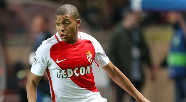 Kylian Mbappe, pictured, is staying at Monaco, Arsene Wenger believes