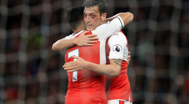 Alexis Sanchez (left) and Mesut Ozil (right) are among several Arsenal players whose contract expire next summer