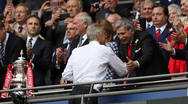 Arsenal majority shareholder Stan Kroenke, right, has come under fire after launching a hunting channel in the UK