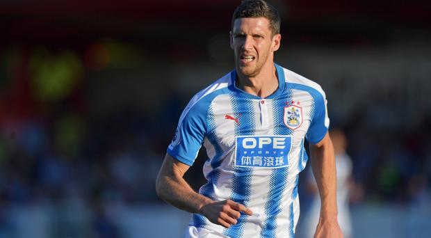Mark Hudson has announced his retirement ahead of the new season and has joined Huddersfield's coaching staff