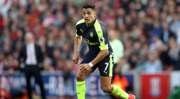 Alexis Sanchez will miss Arsenal's start to the Premier League season with an abdominal injury