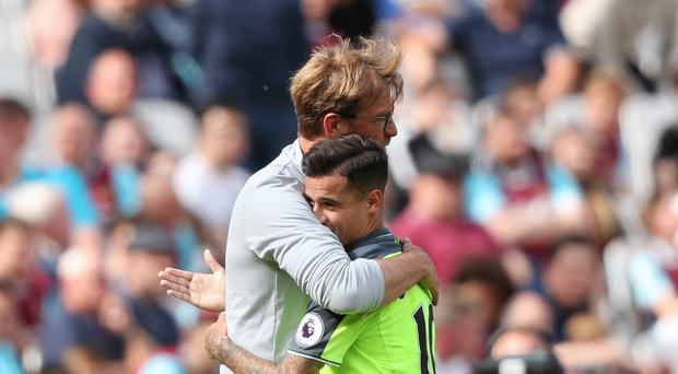 Jurgen Klopp (left) is determined to hold on to Philippe Coutinho (right).