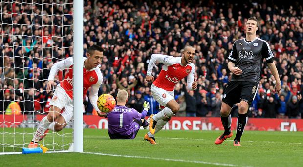 Theo Walcott centre celebrates scoring for Arsenal at home to Leicester last season